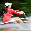 Blurred action of a woman rower by EileenLangsley