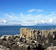 Isle of Eigg from Mallaig. by John Cameron