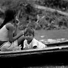 Siblings on the Amazon - Colombia by Anthony Evans