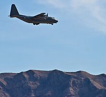 C-130 Hercules and the mountains by Henry Plumley