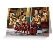 faithful Buddhist monks sitting around Buddha Statues in SHWEDAGON PAGODA Greeting Card