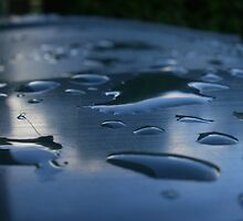 Raindrops on a plastic puddle by chrystalpearson