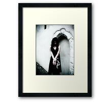 The weight of grief Framed Print