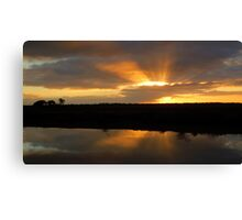 Sunset views over irrigation channel Canvas Print