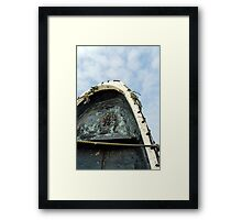 Old boat upright against cloudy Blue sky Framed Print