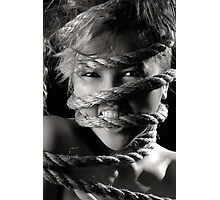 Ropes around beautiful young woman face Photographic Print