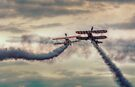 Breitling Stearman Wingwalkers Pass by Nigel Bangert