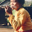 Shan woman with big smoke, Thailand 1979 by John Spies
