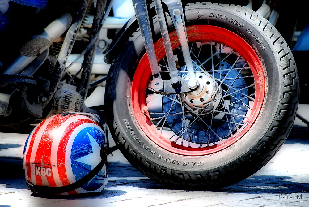 Harley Wheel and Helmet by Karen Martin