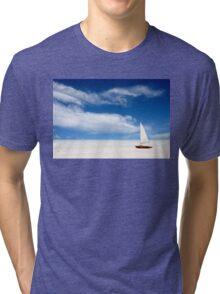 A boat on the beach Tri-blend T-Shirt