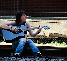 On the tracks with mah guitar by Raymond Hicks