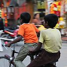friends on a bike by Bimal Tailor