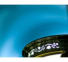 Lamp shining on blue ceiling Photographic Print