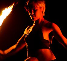 Fire dancing on the back of a friend by Raymond Hicks