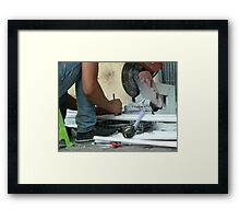 working on the street Framed Print
