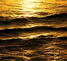 Golden glow on water and waves by Christine Oakley
