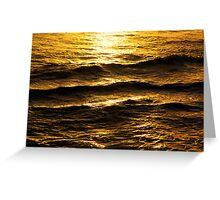Golden glow on water and waves Greeting Card