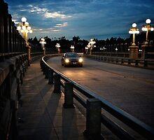Night drive on curved bridge by Karol Franks