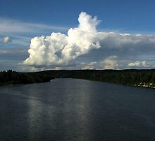 Clouds over the Pic River - park entrance to Pukaswka National park by loralea