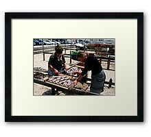 The Ladies Of Nazaré Tend Their Fish Framed Print