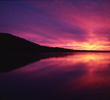 Fiery Sunrise over Thumb Lake, Michigan by John Carpenter