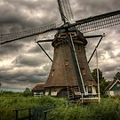 A windmill near Buitenkaag, Holland by Mike Olbinski