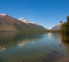 View from the jetty behind Lake McDonald Lodge by Nuttee Ratanapiseth