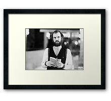 Reading the Book Framed Print