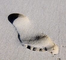 Footprint in the sand by Hege Nolan
