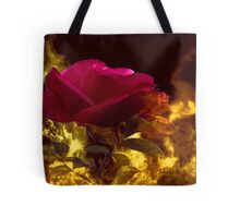 Beautiful rose sitting in the milddle of flames Tote Bag