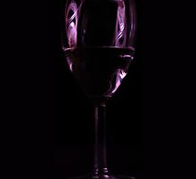 glass reflecting red light by Adam Wakefield