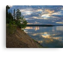 Epic sky and deep water reflection Canvas Print