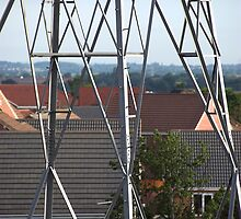 Electric pylons close to modern housing estate by buttonpresser