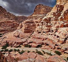 rock landscape with simple tombs in Petra by travel4pictures