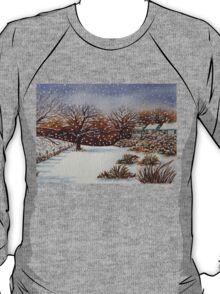 snow scene with snow covered trees and cottages painting  T-Shirt