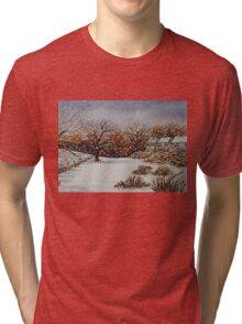 snow scene with snow covered trees and cottages painting  Tri-blend T-Shirt