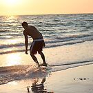 Skim boarding at sunset  by Missy Yoder