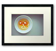 smiling eggs face Framed Print