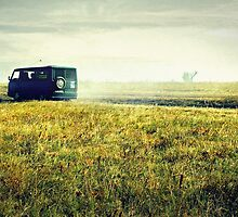 bus sped along the road on the field by Iuliia Dumnova