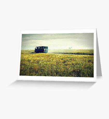 bus sped along the road on the field Greeting Card
