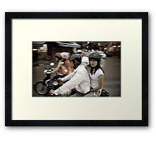 Vietnam.  Scooter couple Framed Print