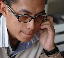young executive make a call by bayu harsa