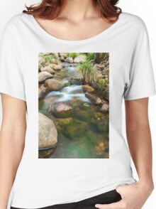Rocks covered in moss in a creek bed. Women's Relaxed Fit T-Shirt
