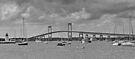 Newport Bay Bridge and Light at Goat Island  by John  Kapusta