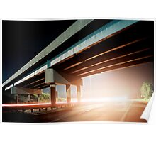Car gliding under the highway Poster