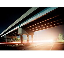Car gliding under the highway Photographic Print