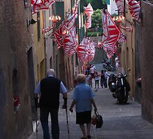 Old couple walking down through streets of Siena during Palio by danworth