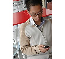 young executive holding mobile phone Photographic Print
