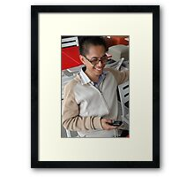 young executive holding mobile phone Framed Print
