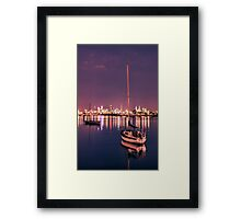 Boat Rests in front of Warm Distant City #1 Framed Print